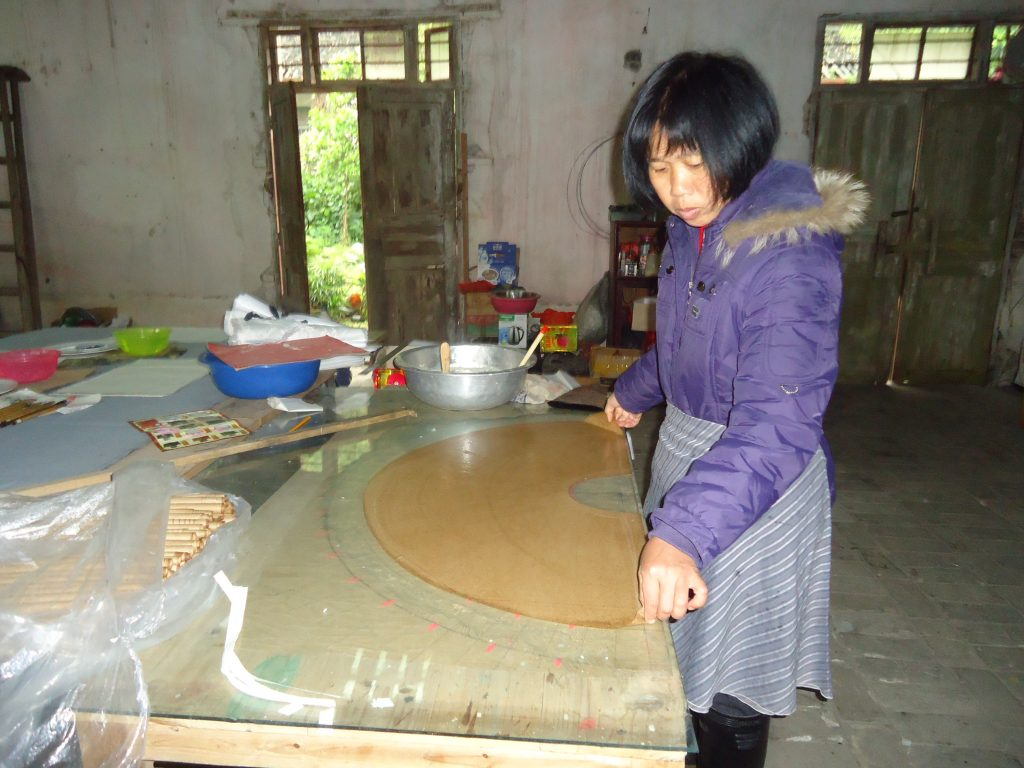 A traditional fan-maker in the small village of Fuli, close to Yangshuo.